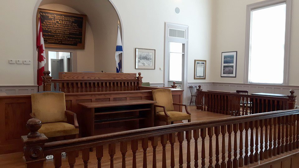 View original Courthouse wooden tables, desks, and railings